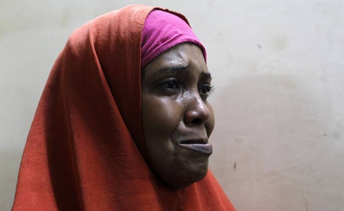 A suspected Somali illegal migrant arrested in a police swoop cries as she prepares to be processed for deportation at a holding station in Nairobi, Kenya.