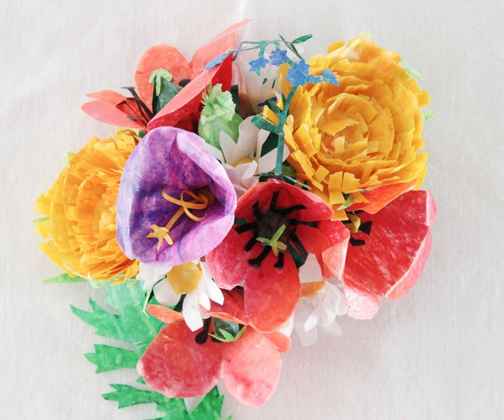 Dipping colored paper flowers into wax helps keep them stiff and in shape.