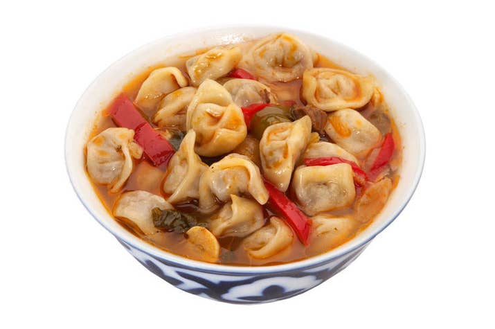 """A soup in which small dumplings are boiled in salt water or bouillon and served with sour milk (""""suzma"""") and seasoned with pepper, onion, tomato paste, black pepper, and sour cream."""