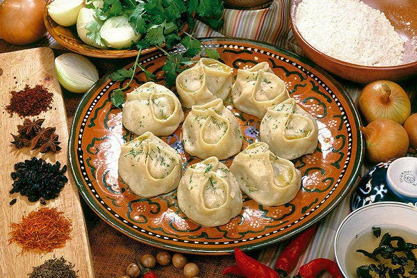 Steamed dumplings sprinkled with dill and served with sour cream. Meat, spices, or vegetables can make up the stuffing, so you never know what you're going to get!