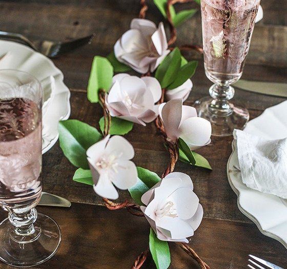 Create the perfect spring tablescape with beautiful folded apple blossom branches.
