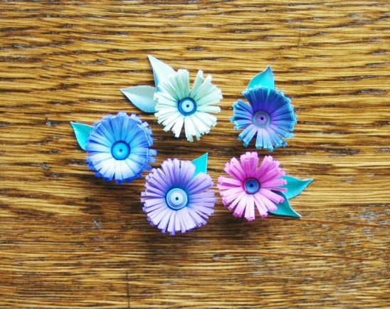 These fringed paper flowers make perfect pins and hair accessories.