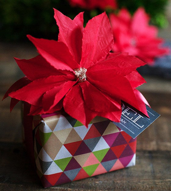 Save your cocktail napkins and use them to make these gorgeous paper poinsettias!