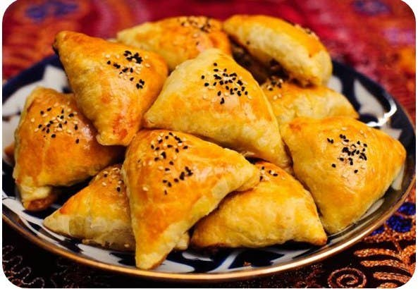 A triangular dough pastry that's baked in a tandoor oven so that the bread is somehow both crunchy and super-soft. Like manty, they can be filled with a variety of things, including ground lamb, herbs, and, the most interesting traditional option, pumpkin.