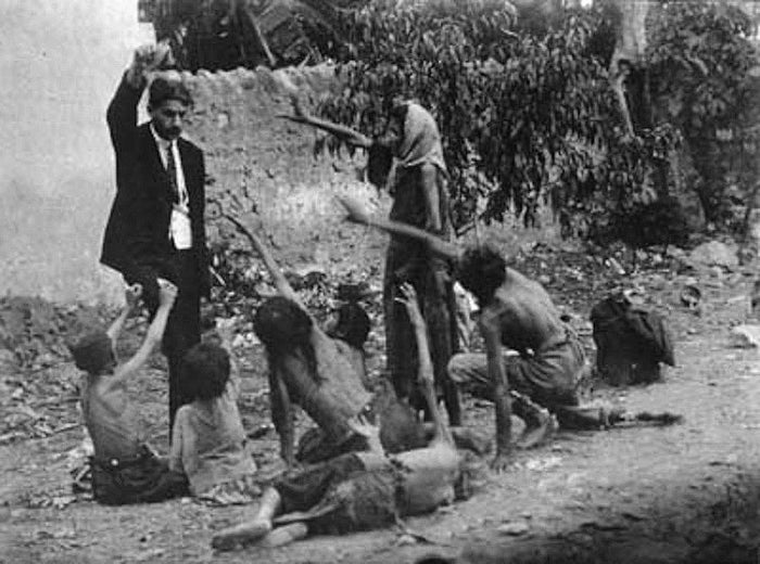 They kidnapped children, converted them to Islam and adopted them out to Turkish families. The photo shows an alleged Turkish official teasing Armenian children with food.