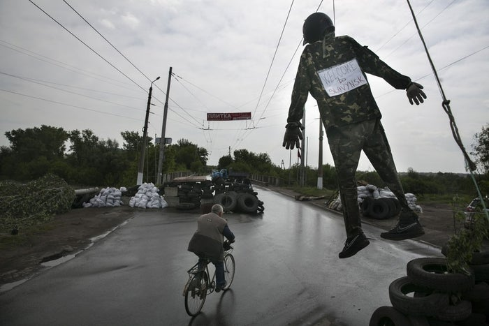 A figure hangs at a pro-Russia checkpoint near the town of Slovyansk in eastern Ukraine.