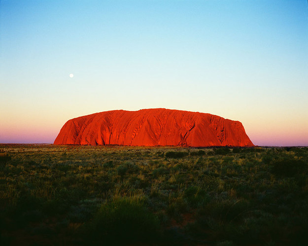 Watch the sun set over Uluru.