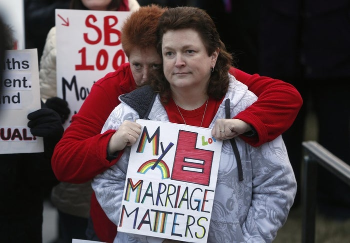 Cindy Bednarz, left, and her wife Lisa Bednarz attend a marriage equality rally at Utah's State Capitol building in Salt Lake City, Utah January 28, 2014.