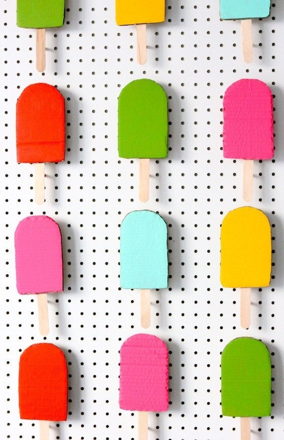 A little acrylic paint and popsicle sticks transform plain cardboard into a sweet summer photo booth/art installation that will never, ever melt. Directions here.