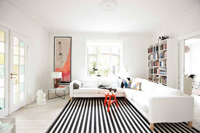 Just Like Vertical Stripes On Clothing A Striped Rug Will Make Your Room Ear Longer