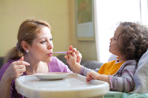 If your baby seems to dislike their baby food, show them how it's really done by taking a bite too!