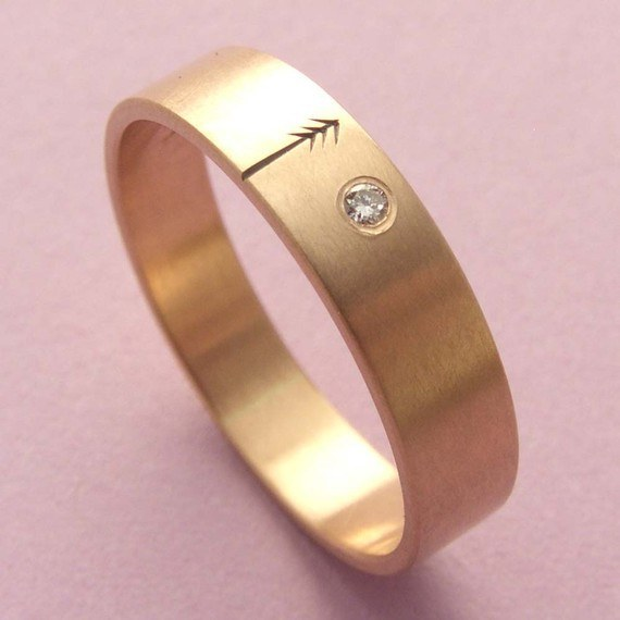 This rose gold ring with diamond.