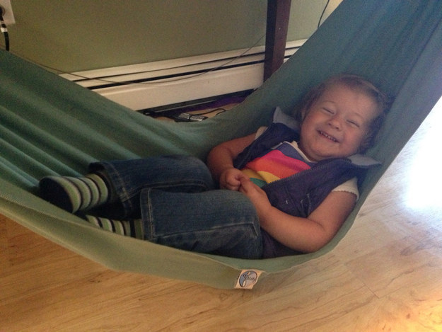 Toys are great, but tying a blanket around a table makes a really entertaining hammock on a rainy day.
