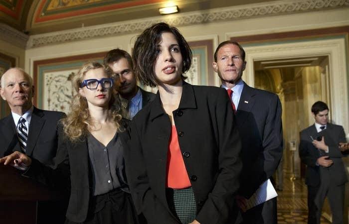 Nadya Tolokonnikova (center) and Maria Alyokhina (center left) of Pussy Riot.