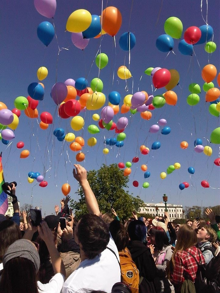Hooligans Disrupt Russian LGBT Rights Event By Popping Pink Triangle Balloons