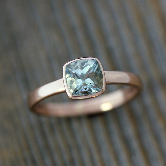 This aquamarine cushion gemstone set in recycled rose gold.