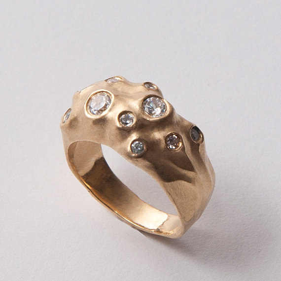 This gold and diamond moon-like engagement ring.
