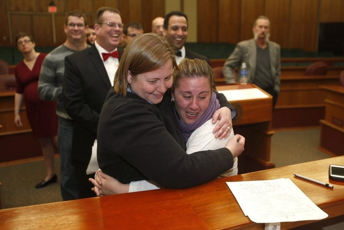 Mary Black (left) and her wife Sarah Weinstein hug after being married by Oakland County Clerk Lisa Brown at the Oakland County Courthouse on March 22.