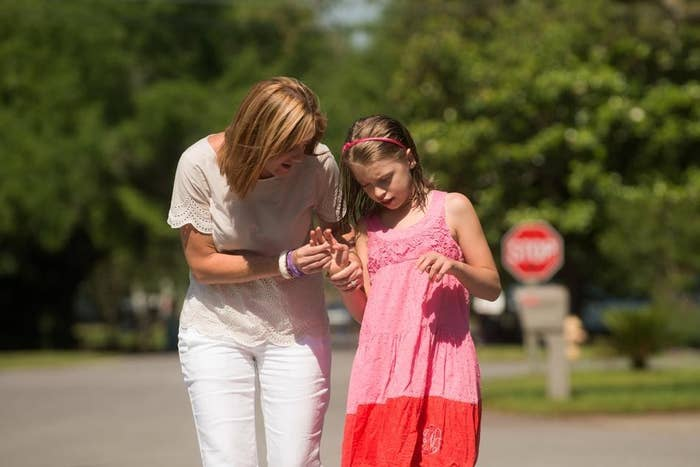 Holley Moseley and her daughter RayAnn walk to the park in their neighborhood in Gulf Breeze, Fla., on May 21, 2014. RayAnn, who is severely epileptic, was an inspiration for Florida's legislation.
