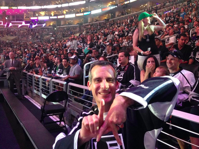 "Los Angeles Mayor Garcetti flashes an ""L.A."" hand sign during a rally celebrating the Kings' Stanley Cup victory."