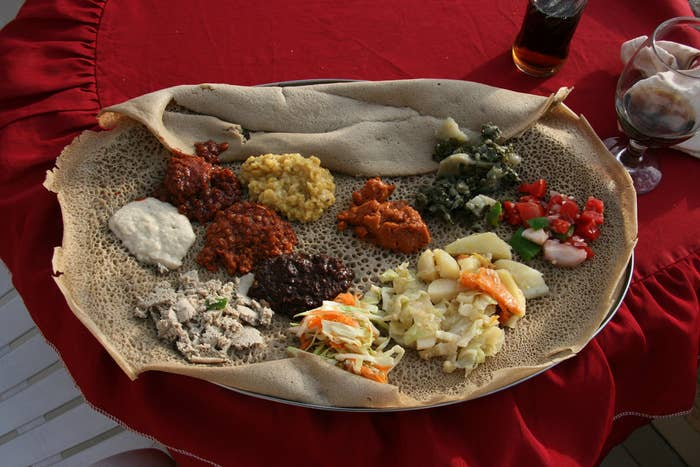 Ethiopia's cuisine is very similar to the food of its neighbor and rival Eritrea (which until 1991 was part of Ethiopia). Some of the country's culinary style also reflects the influences of neighbors like Sudan (where the sour bread is called kesra), and the lasting impact of Italy's partial colonial rule in the mid-1900's.
