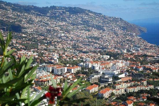 The capital of an island off the coast of North Africa, Funchal's Portuguese influence is obvious. The city unfolds over a series of steep hills, and enjoys one the most beautiful coastal settings of any city in the world. A trip by cable car to the parish district of 'Monte', 3363 feet (1025m) above the sea, highlights this beautiful city in all its glory.