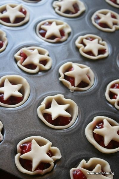 Use a cookie cutter to cut the dough in circles, fill with pie filling, and top with star dough cutouts.