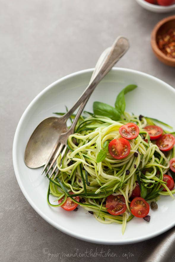 12 light and delicious veggie noodle recipes fresh zucchini tangy caper olive sauce and sweet cherry tomatoes make for a light forumfinder Choice Image