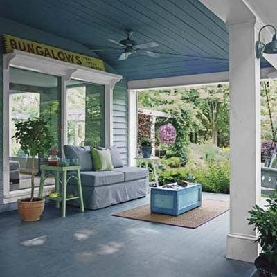 Take a few indoor comforts with you when you go outside this season. Create your own cool breeze with a porch ceiling fan. And, don't limit yourself to outdoor furniture that's hard plastic. Go for plush, weatherproof seating and brightly-painted end tables. While you're at it, throw down an outdoor rug, a few planters, and a coffee table. Now, just look at all the livable space you just added to your house for the summer. Take a tour of the rest of this outdoor space.
