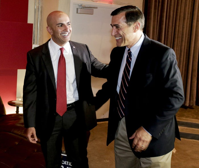 Neel Kashkari (left) arrives with Rep. Darrell Issa, R-Calif., for an election night party at the Port Theater in Newport Beach, Calif., on Tuesday.