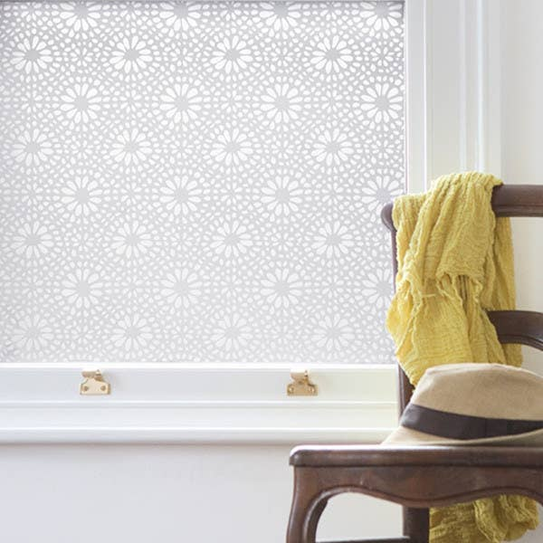 """Block the view of your exhibitionist neighbors. Cover a portion of your window with peel-and-stick decals. They cost less and let in more light plain old blinds and drapes. Try Emma Jeffs Otto Adhesive Film, about $86 for a 40"""" x 50"""" sheet; 2jane.com."""