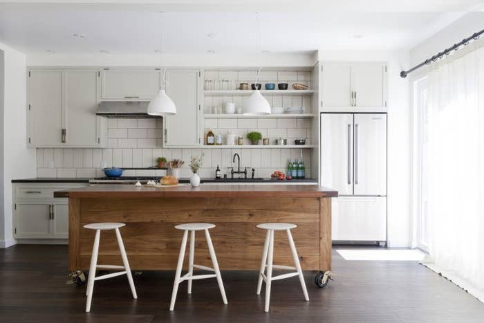 Interior designers love this look because it makes a small space look bigger. Remove the clunky doors from your cabinets—stashing all hinges and screws where you can find them later—and let the light illuminate your space! Then rearrange your shelves for the best #shelfie ever. RELATED: Paint your kitchen cabinets these color combos (if you're allowed)