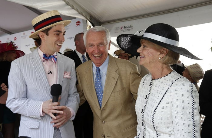 """Kentucky Gov. Steve Beshear (center) and his wife, Jane, are interviewed by """"Todd the Intern"""" before the 140th running of the Kentucky Derby at Churchill Downs in Louisville, Ky., Saturday, May, 3."""