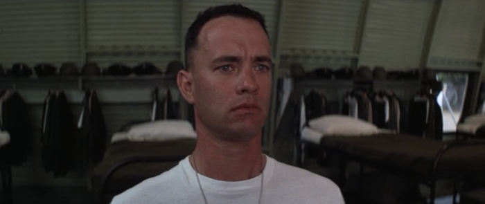 "Not only is Forrest Gump (Tom Hanks) a superhuman with no emotions other than ""happy"" and ""sad,"" he also has no agency. His life is almost entirely a series of fortunate accidents. He just coasts through, accidentally getting recruited to play football in college; accidentally getting recruited to the Army, where he accidentally saves a bunch of people while looking for his buddy; accidentally being discovered as a Ping-Pong prodigy; and accidentally becoming a successful shrimper after a storm wipes out his competitors. Since he's not doing anything intentionally, he remains pure and innocent (e.g., he's not responsible for anyone he might have killed in Vietnam). This is what he says when explaining why he fits in the Army: ""It's not really hard. You just make your bed real neat and remember to stand up straight and always answer every question with, 'Yes, drill sergeant.'"" Forrest is very good at doing what other people tell him to do."