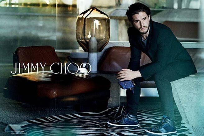 Kit Harington, (along with his head of contractually-bound hair) has a new summer job: smoldering professionally for Jimmy Choo's latest menswear campaign.