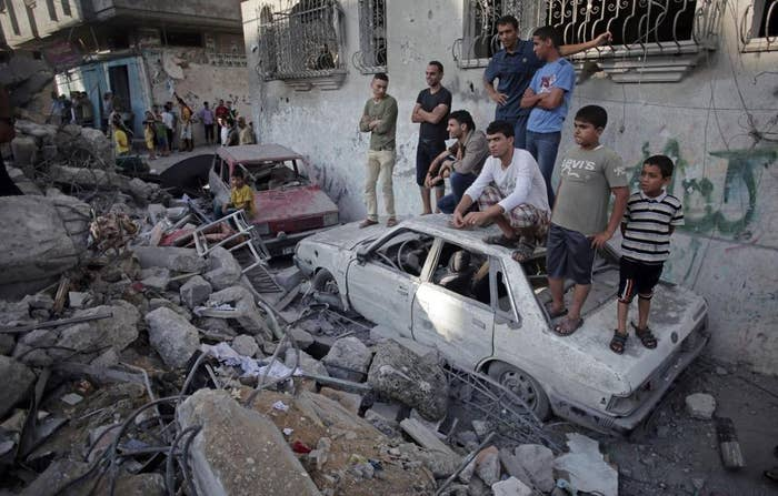 Palestinians gather at the destroyed home of the Ghannam family. Five members of the family were killed after an Israeli missile strike hit their home early morning in the Rafah refugee camp in the southern Gaza Strip.