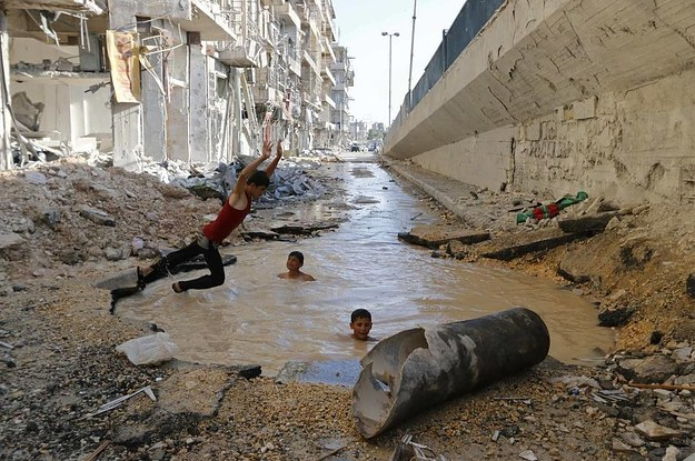 Kids In Syria Are Swimming In Pools Made By Bomb Craters Because