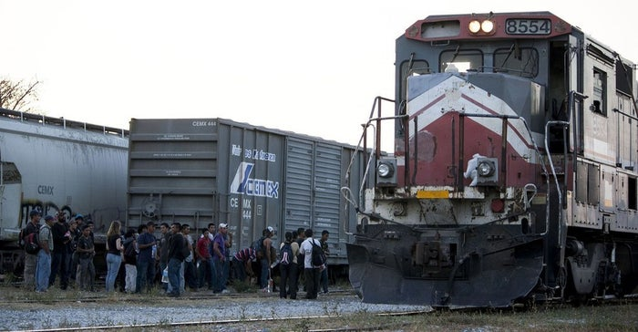 "People wait in Mexico to stow away on the freight train known as ""La Bestia"" for a trip toward the U.S. border."