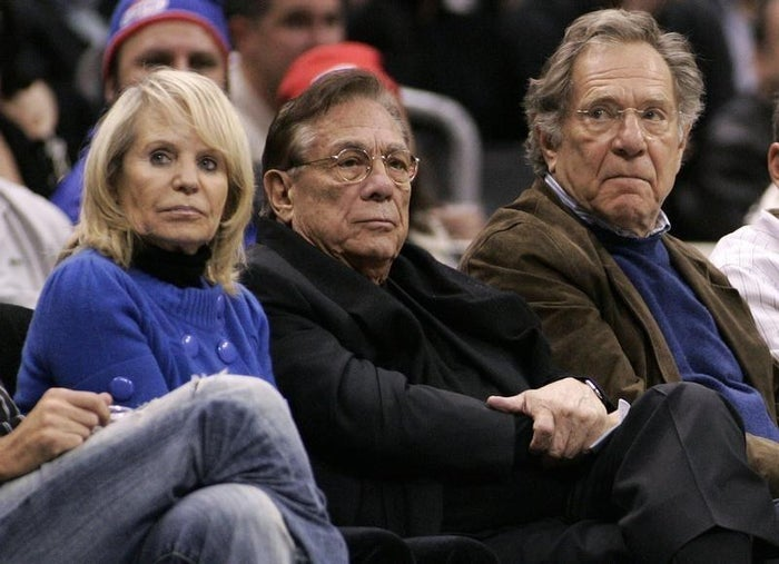 Los Angeles Clippers owner Donald Sterling (center) and his wife, Shelly, (left) at a Clippers game in 2008.