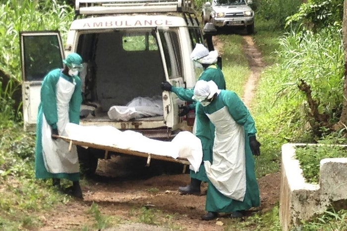 Health workers carry the body of an Ebola virus victim in Kenema, Sierra Leone, in June. Neighboring Liberia is also struggling with the disease, which was first documented in Guinea in March.