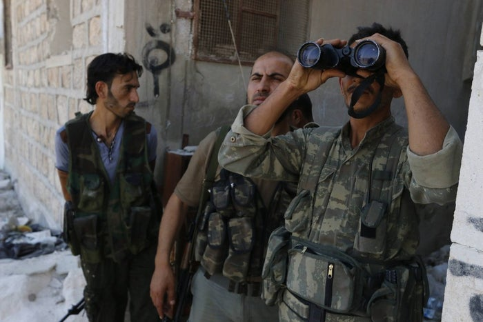 Rebel fighters in Aleppo