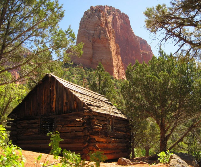 This old cabin in Zion's Kolob Canyons is located in a section that's surrounded by colorful rock formations and hiking trails.