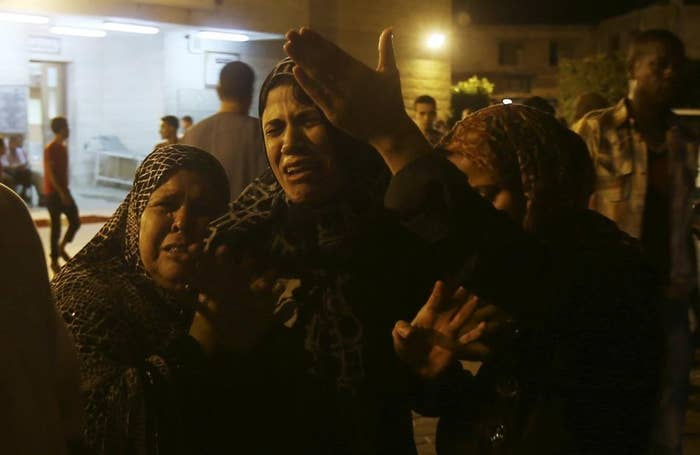 Women mourn after an Israeli air strike killed two Palestinian militants, at a hospital morgue in the central Gaza Strip