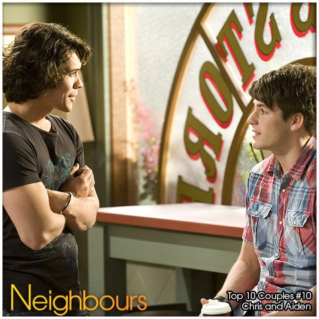 A handsome nurse and a cute basketball captain provided Neighbours with its first gay male couple and won all of our hearts. From the moment Chris was taken into hospital after a nasty beating, sparks between him and a curly haired Aiden flew over the painkillers and dodgy food. A clumsy game of pool and a BBQ later and the pair found themselves an official item and number 10 in Top 10 Neighbours Couples of All Time BuzzFeed list.