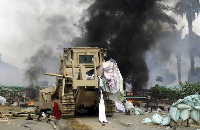 A torn poster of ousted Egyptian President Mohamed Mursi as riot police violently clear the Rabaa Adawiya square sit-in of anti-government and pro-Muslim Brotherhood protestors on August 14, 2013.
