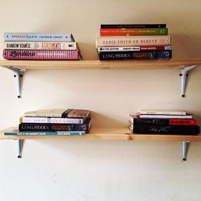 """I got a new bed and didn't know what to do with the wooden slats from my old frame, so I bought some L-brackets (.97 a piece!) and turned them into shelves."""