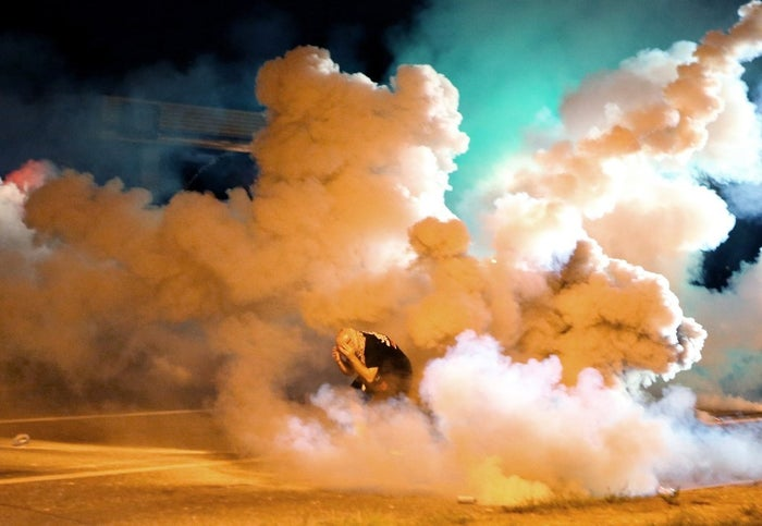 A protester engulfed in smoke Wednesday.