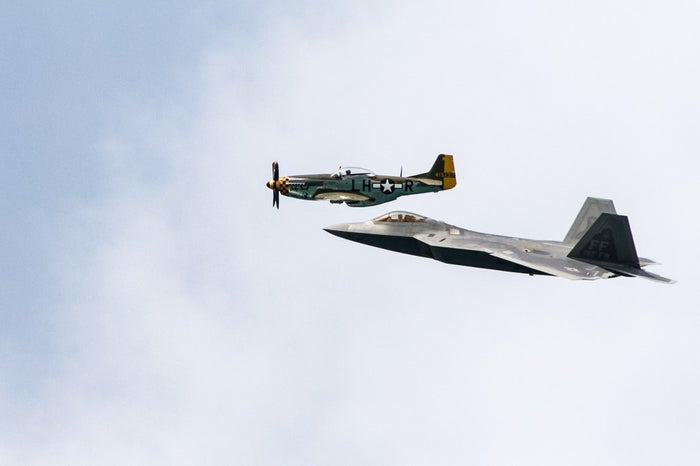 Look at the pilots! Pictured here are an F-22 Raptor and a P-51 Mustang.