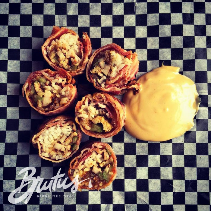 That's bacon wrapped around chicken confit, dates, and celery, topped with soy mayo, maple syrup, and Dijon mustard.