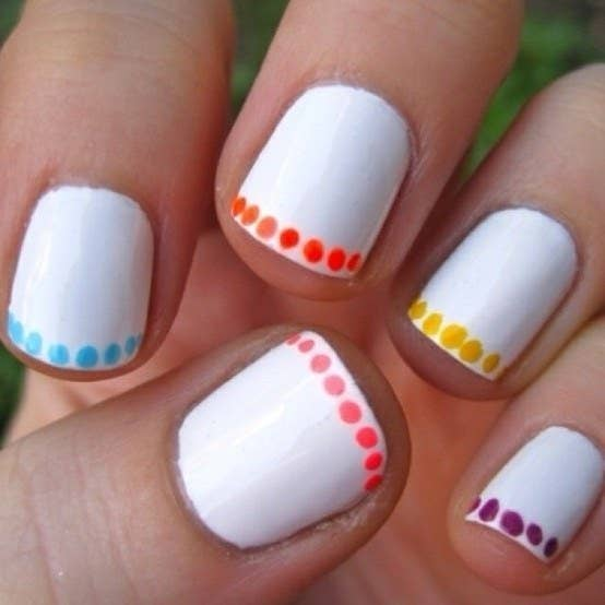 For a cool touch, just do a line of polkadots around the edge of your nail. - 27 Lazy Girl Nail Art Ideas That Are Actually Easy